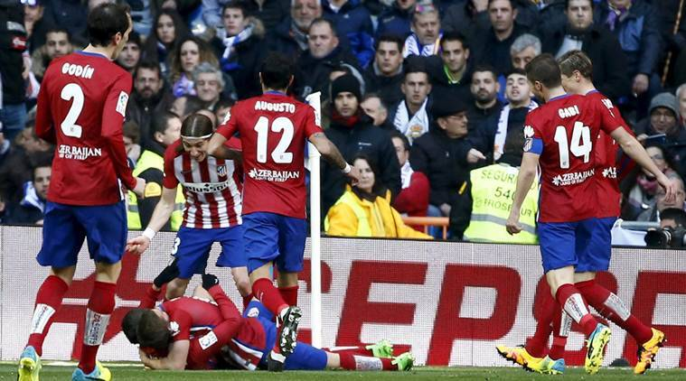 Atletico Madrid's players celebrate their first goal during the match