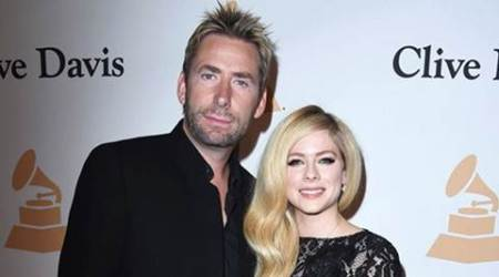 Avril Lavigne, Chad Kroeger show affection at pre-Grammyparty