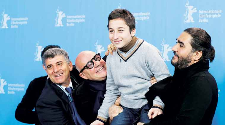 The team for Fire at Sea pose at the 2016 Berlinale Film Festival on Saturday.  (Source: AP)