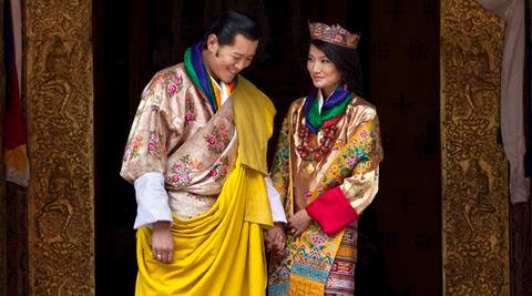 FILE - This Oct. 13, 2011 file photo Queen Jetsun Pema, right, looks at King Jigme Khesar Namgyal Wangchuck as they pose after they were married at the Punakha Dzong in Punakha, Bhutan. The tiny Himalayan nation of Bhutan has a new crown prince. The Royal Media Office in capital Thimphu said Saturday that the baby boy was born on Friday. (AP Photo/Kevin Frayer, File)
