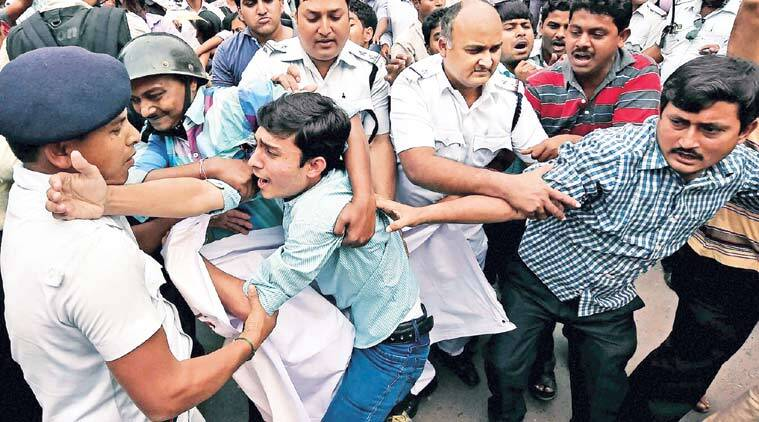 Police detain SUCI workers protesting against 'anamolies' in supply of digital ration cards, in Kolkata Thursday. (Source: PTI)