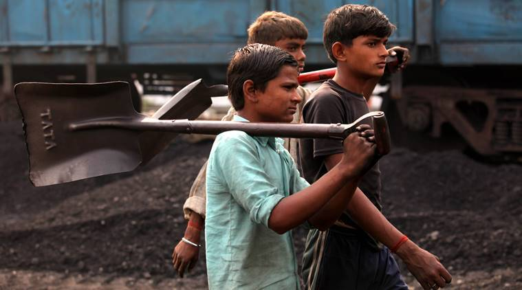 Child labourers going back to home after finishing their work at the Katra railway station to unload the coal from the train in Gonda (UP) on Nov 11th 2012. Express photo by RAVI KANOJIA.