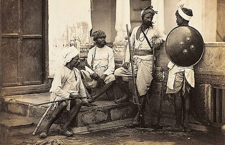 This photograph is part of a series taken by the firm of Shepherd and Robertson for a book entitled 'The People of India' by Forbes Watson, published in 1868. Chohan Rajpoots were classified as the highest secular Hindu caste during the British regime.