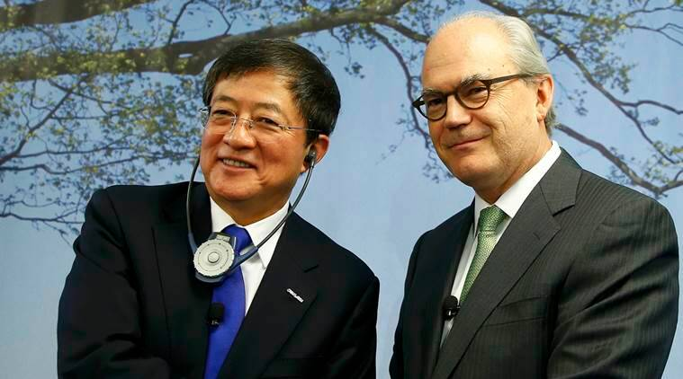 Ren Jianxin, Chairman of China National Chemical Corp shakes hands with Swiss agrochemicals maker Syngenta's President Michel Demare (R) after the company's annual news conference in Basel, Switzerland February 3, 2016. China made its boldest overseas takeover move yet when state-owned ChemChina agreed a  billion bid for Swiss seeds and pesticides group Syngenta on Wednesday. The largest ever foreign purchase by a Chinese firm, announced by both companies, will accelerate a shake-up in global agrochemicals and marks a setback for U.S. firm Monsanto, which failed to buy Syngenta last year. REUTERS/Arnd Wiegmann