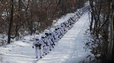 Soldiers of China's People's Liberation Army (PLA) walk through woods as the temperature reaches below minus 30 degrees Celsius (minus 22 degrees Fahrenheit) in Heihe, Heilongjiang province, January 20, 2016. Picture taken January 20, 2016. REUTERS/Stringer ATTENTION EDITORS - THIS PICTURE WAS PROVIDED BY A THIRD PARTY. THIS PICTURE IS DISTRIBUTED EXACTLY AS RECEIVED BY REUTERS, AS A SERVICE TO CLIENTS. CHINA OUT. NO COMMERCIAL OR EDITORIAL SALES IN CHINA.