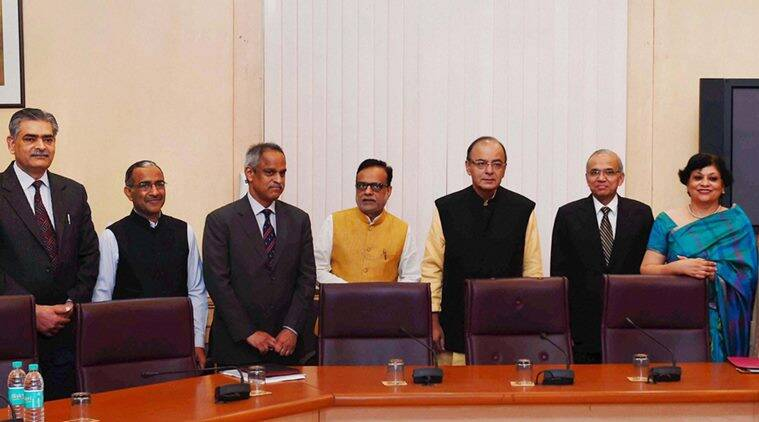 New Delhi: Union Minister for Finance, Corporate Affairs and Information & Broadcasting, Arun Jaitley pose with group photo with the members of the Economic Division who assisted in the preparation of Economic Survey, in New Delhi on Thursday.PTI Photo by Shahbaz Khan(PTI2_25_2016_000031b)