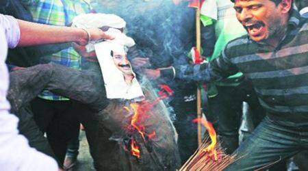 Youth Congress activists burn effigy of Delhi CM Kejriwal