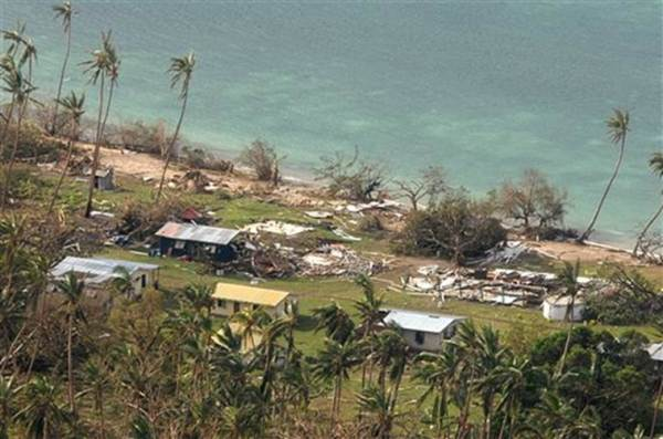 In this Sunday, Feb. 21, 2016 aerial photo supplied by the New Zealand Defense Force, debris is scattered around damaged buildings at Susui village in Fiji, after Cyclone Winston tore through the island nation. Fijians were finally able to venture outside Monday after authorities lifted a curfew but much of the country remained without electricity in the wake of a ferocious cyclone that left at least six people dead and destroyed hundreds of homes. (New Zealand Defense Force via AP) EDITORIAL USE ONLY