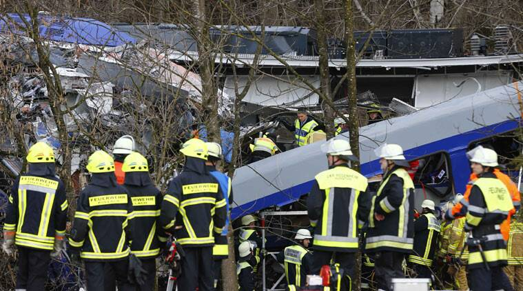 Rescue personnel stand in front of two trains that collided head-on near Bad Aibling, southern Germany. AP Photo