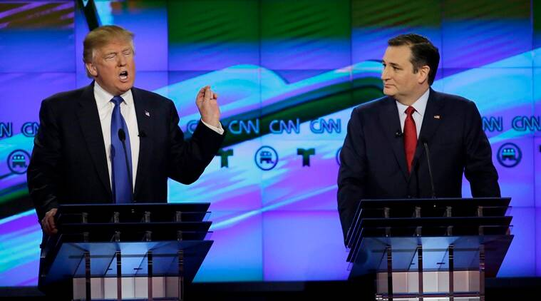 Republican presidential candidate, businessman Donald Trump , left, speaks as Republican presidential candidate, Sen. Ted Cruz, R-Texas,  looks on during a Republican presidential primary debate at The University of Houston, Thursday, Feb. 25, 2016, in Houston. (AP Photo/David J. Phillip)
