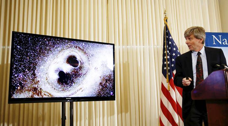 Dr. David Reitze, Executive Director of the LIGO Laboratory at Caltech, shows the merging of two black holes at a news conference to discuss the detection of gravitational waves, ripples in space and time hypothesized by physicist Albert Einstein a century ago, in Washington February 11, 2016. The waves were detected by twin Laser Interferometer Gravitational-wave detectors (LIGO) in Louisiana and Washington states in September 2015.     REUTERS/Gary Cameron