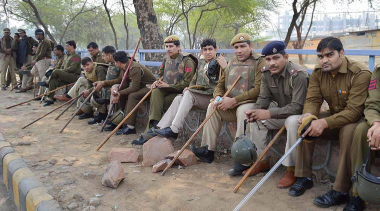 Gurgaon: Policemen guard in Gurgaon on Saturday during their agitation for reservation. PTI Photo (PTI2_20_2016_000214B)