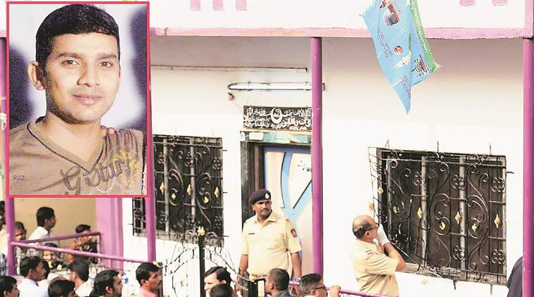 Mumbai: Police inspecting the house where a 35-year-old man Hasan Warekar (inset) allegedly killed 14 of his family members and then committed suicide in the Kasarwadavli area in Thane on Sunday. PTI Photo
