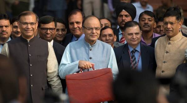 Indian Finance Minister Arun Jaitley, center, leaves for annual budget presentation at parliament in New Delhi, India, Monday, Feb. 29, 2016. It was Jaitley's second full budget since Prime Minister Narendra Modi won a huge majority in national election in 2014, on the back of promises to turn around the economy and boost job creation. There have been few sweeping reforms in the past two years that the government has been promising. (AP Photo /Tsering Topgyal)
