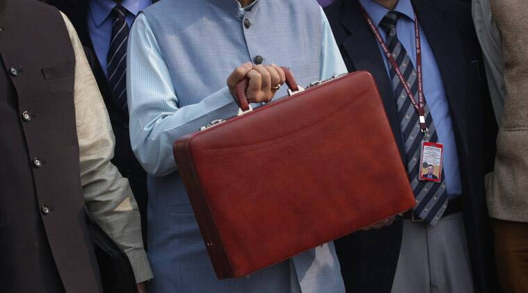 Union Finance Minister Arun Jaitley holds the bag containing the papers for the Union Budget as he comes to present the Budget at the Parliament on Monday. (Express Photo by Neeraj Priyadarshi)