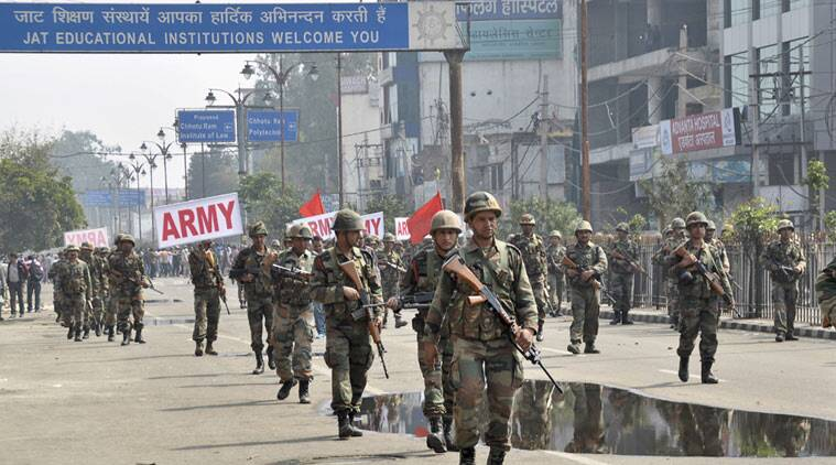 Indian army soldiers conduct a flag march at Rohtak, after Friday was rocked with violence in Haryana state, India, Saturday, Feb. 20, 2016. (Source: PTI)