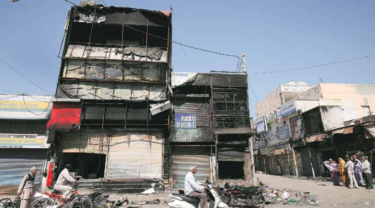 Selective burning Jat-owned Haryana Book Depot spared, shops on either side set ablaze, in Jhajjar. Ravi Kanojia