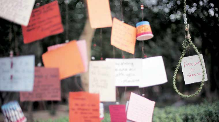 Postcards hung near the JNU Administration block Sunday. (Express Photo: Oinam Anand)