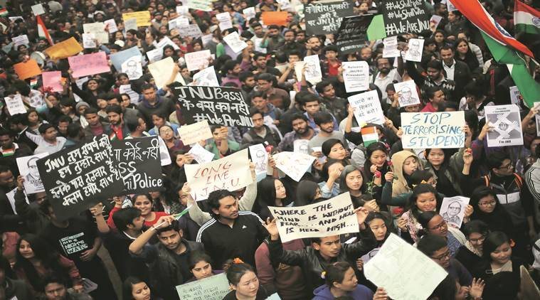 Demonstrators shout slogans as they hold placards during a protest demanding the release of Kanhaiya Kumar, a Jawaharlal Nehru University (JNU) student union leader accused of sedition, in New Delhi on Thursday. (Express photo by Oinam Anand)