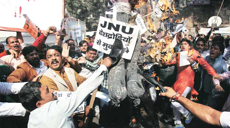 Activists of Bajrang Dal and Vishwa Hindu Parishad organise a protest outside JNU Tuesday, shouting slogans and burning effigies of the JNU Vice-Chancellor. (Express Photo Tashi Tobgyal)