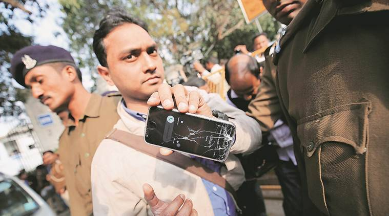 The Indian Express reporter Alok Singh's mobile phone was snatched away and broken. (Source: Express photo)