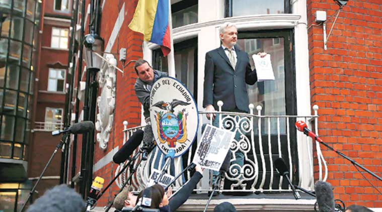 Assange holds a copy of the UN ruling at the Ecuadorian embassy in London. (Source: Reuters)