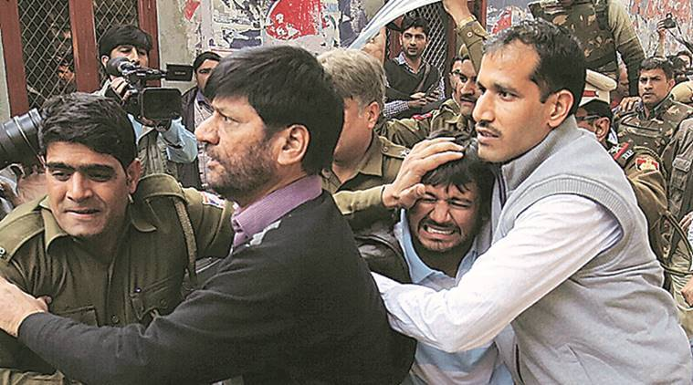 Kanhaiya Kumar, head of the student's union at Delhi's Jawaharlal Nehru University (JNU), is escorted by police outside the Patiala House court in New Delhi, February 17, 2016. Fighting broke out on Wednesday around Delhi's Patiala House court hearing a case against Kumar accused of sedition, a charge that has sparked protests across university campuses and criticism the government was curtailing free speech.Express Photo BY- Praveen Khanna