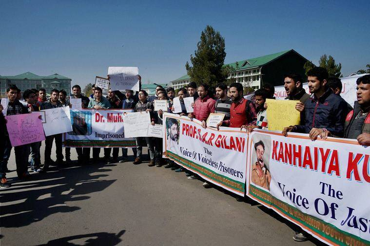Students of Kashmir University chant slogans and hold placards during a protest in solidarity with students and staff of Jawaharlal Nehru University (JNU). PTI Photo