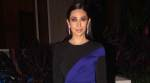 Karisma Kapoor avoids question on divorce, says not ready for films