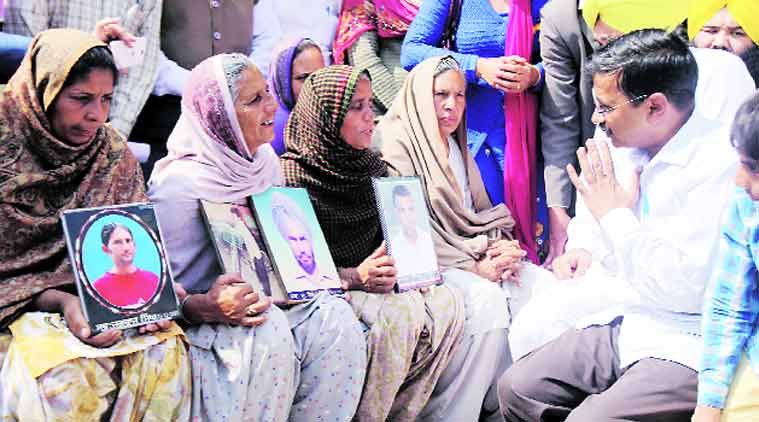 Kejriwal with wives of farmers who committed suicide, in Sangrur Thursday. (Express Photo: Gurmeet Singh)
