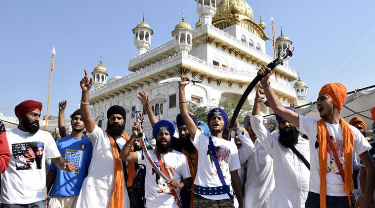 Sikh youth flashing swords and raising slogans in praise of Khalistan taking round of Parikarma of Golden Temple  on the occasion of anniversary of Operation Bluestar on Saturday, June 6 2015. EXPRESS PHOTO BY RANA SIMRANJIT SINGH