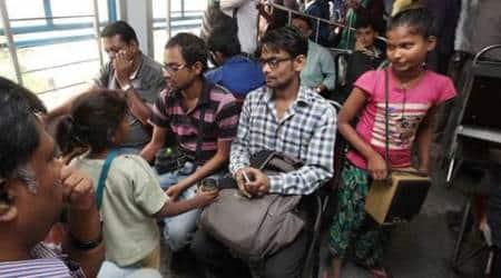 indian railways, local train performers, sealdah station, kolkata local train, sealdah train line, child beggar, train singer, street performers, poverty, india news, west bengal news, kolkata news, latest news