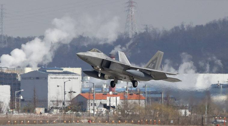 One of four U.S. F-22 stealth fighters prepares to land at Osan Air Base in Pyeongtaek, South Korea, Wednesday, Feb. 17, 2016. (AP Photo)