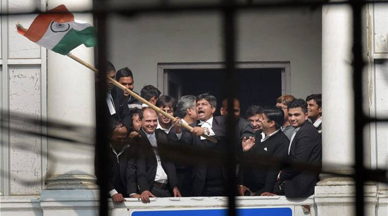 A lawyer waves a Tricolour at Patiala House Courts where JNUSU President Kanhaiya Kumar, arrested on charges of sedition, was being produced in New Delhi on Wednesday. (PTI Photo)