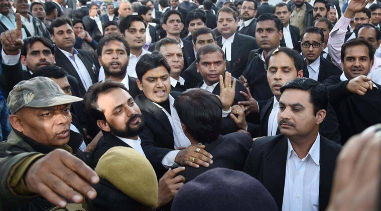 Advocates clash with the JNU students who were protesting against the arrest of JNUSU President Kanhaiya Kumar at Patiala House Courts in New Delhi on Monday. (PTI Photo by Atul Yadav)