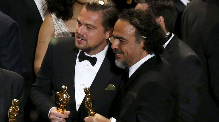 Director Alejandro Inarritu and actor Leonardo DiCaprio hold their Oscars after the end of the awards ceremony at the 88th Academy Awards in Hollywood