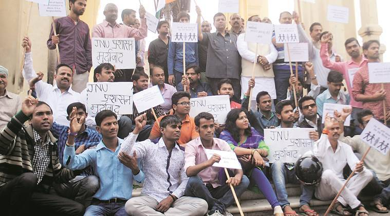 Members of Awadh Intelectual Forum hold a protest against JNU Administration at in front of Gandhi Statue in Lucknow on Sunday. Express Photo by Pramod Adhikari