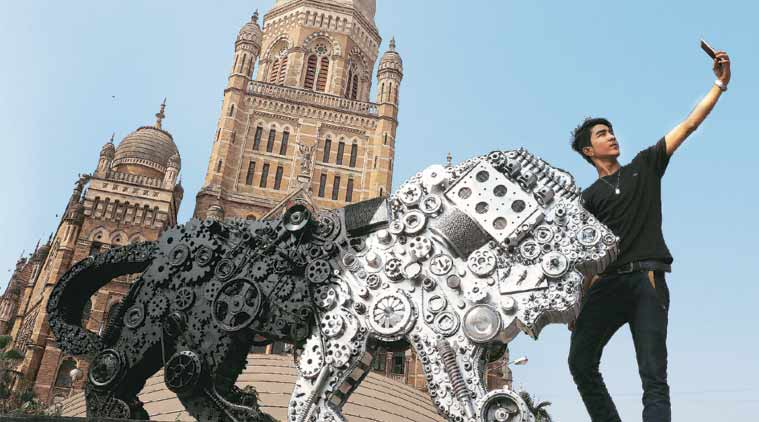 A boy clicks a selfie with the Make in India mascot outside the BMC office. (Express Photo: Prashant Nadkar)