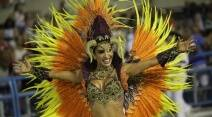 A performer from Mocidade samba school parades during the Carnival celebrations at the Sambadrome in Rio de Janeiro, Brazil, Monday, Feb. 8, 2016. (AP Photo/Leo Correa)
