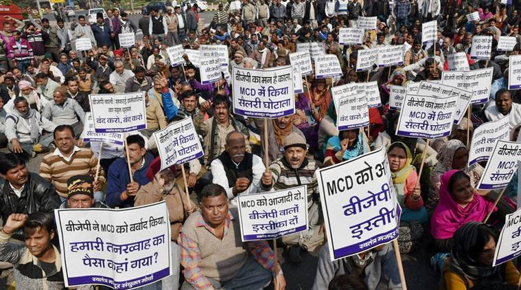 New Delhi: MCD workers staging a protest demanding funds from the Centre at Boat Club in New Delhi on Saturday. PTI Photo by Atul Yadav(PTI2_6_2016_000041B)