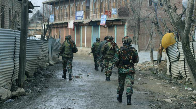 Troops in action during encounter in Hajin area of Bandipora District. (Source: Express Photo by Shuaib Masoodi)