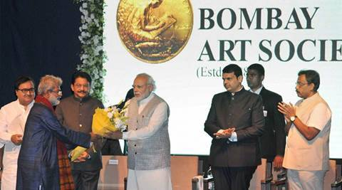 Mumbai: Prime Minister Narendra Modi being greeted at the inauguration of Bombay Art Society's new building complex in Mumbai on Saturday. Maharashtra C. Vidyasagar Rao and Chief Minister Devendra Fadnavis are also seen. PTI Photo  	(PTI2_13_2016_000068B)