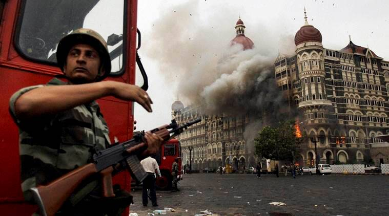 """Mumbai: **FILE** Smoke is seen billowing out of the ground and first floor of the Taj Hotel in south Mumbai during security personnel's """"Operation Cyclone"""" following the 26/11 terror attacks in 2008. Lashkar-e-Taiba (LeT) operative David Coleman Headley deposed on Monday at a Mumbai court through a video link. PTI Photo (PTI2_8_2016_000258B)"""