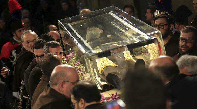 The exhumed body of the mystic saint Padre Pio is carried inside the Catholic church of San Lorenzo fuori le Mura in Rome. (Photo: Reuters)