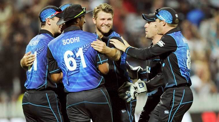 New Zealand's Corey Anderson, center, celebrates with his teammates after dismissing Australia's John Hastings for 6 in the 3rd One Day International Cricket match at Seddon Park in Hamilton, New Zealand, Monday, Feb. 8, 2016. (Ross Setford/SNPA via AP) NEW ZEALAND OUT