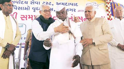 Gujarat Governor O P Kohli and Somabhai Modi (right) felicitate Dalits in Vadnagar on Saturday. Javed Raja