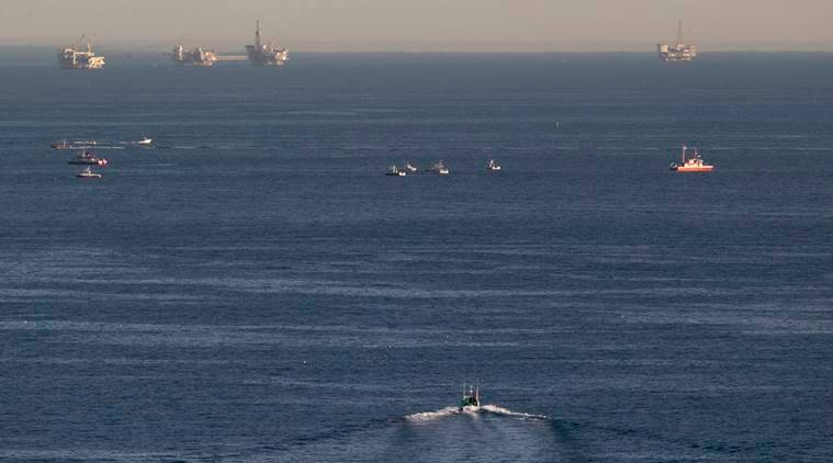 Rescue boats search for wreckage from two small planes that collided in midair and plunged into the ocean off of Los Angeles harbor Friday, Feb. 5, 2016, in San Pedro, Calif. There was no immediate word of any survivors, authorities said. The planes collided at around 3:30 p.m. and apparently went into the water about two miles outside the harbor entrance, U.S. Coast Guard and other officials said. (AP Photo/Damian Dovarganes)
