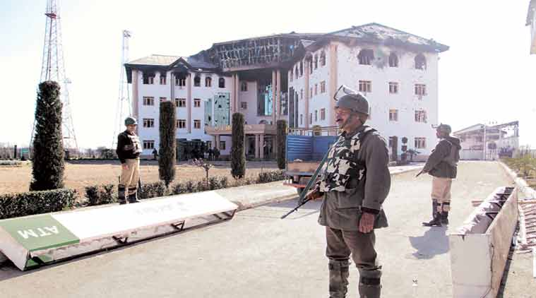 Security personnel at the EDI campus at Pampore on Tuesday. (Express Photo: Shuaib Masoodi)