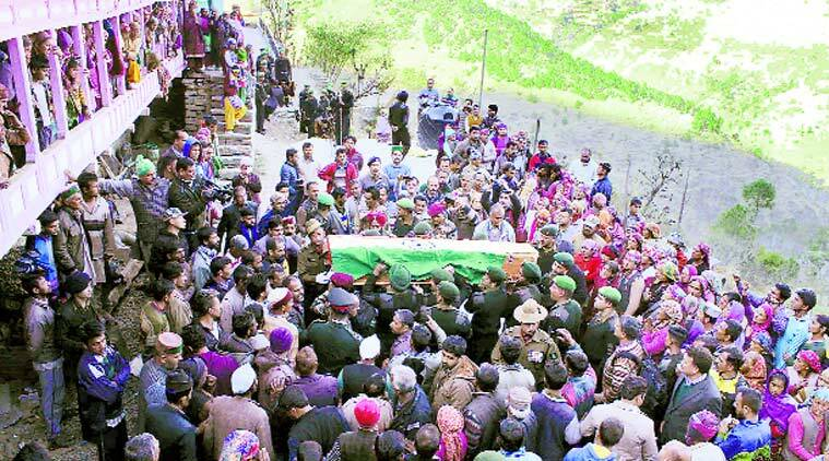 Army personnel and residents pay tribute to Lance Naik Om Prakash, who was killed in the Pampore attack, at Chikhar village near Shimla on Monday. Lalit Kumar