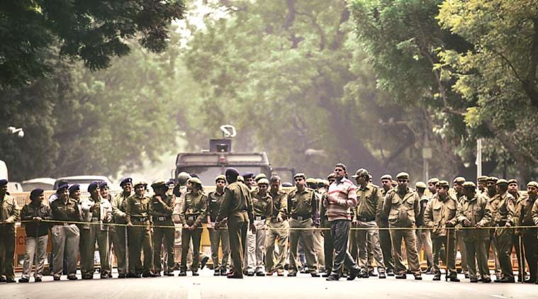 Delhi Police personnel at Parliament Street, minutes before hundreds of JNU students, teachers, artists and leaders marched into the area Thursday. (Express Photo Tashi Tobgyal)